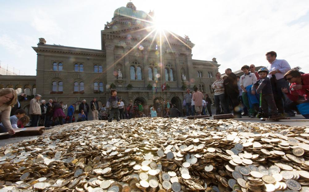 In a publicity stunt this fall, advocates of the guaranteed income proposal dumped eight million coins outside the Parliament building in Bern — one for every Swiss citizen. (Kopf oder Zahl/Flickr)