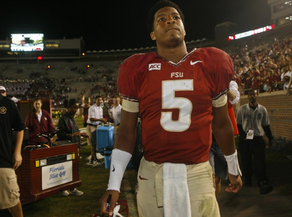 Florida State quarterback Jameis Winston is the top candidate for the Heisman Trophy. He's also under investigation for sexual assault. (Phil Sears/AP)