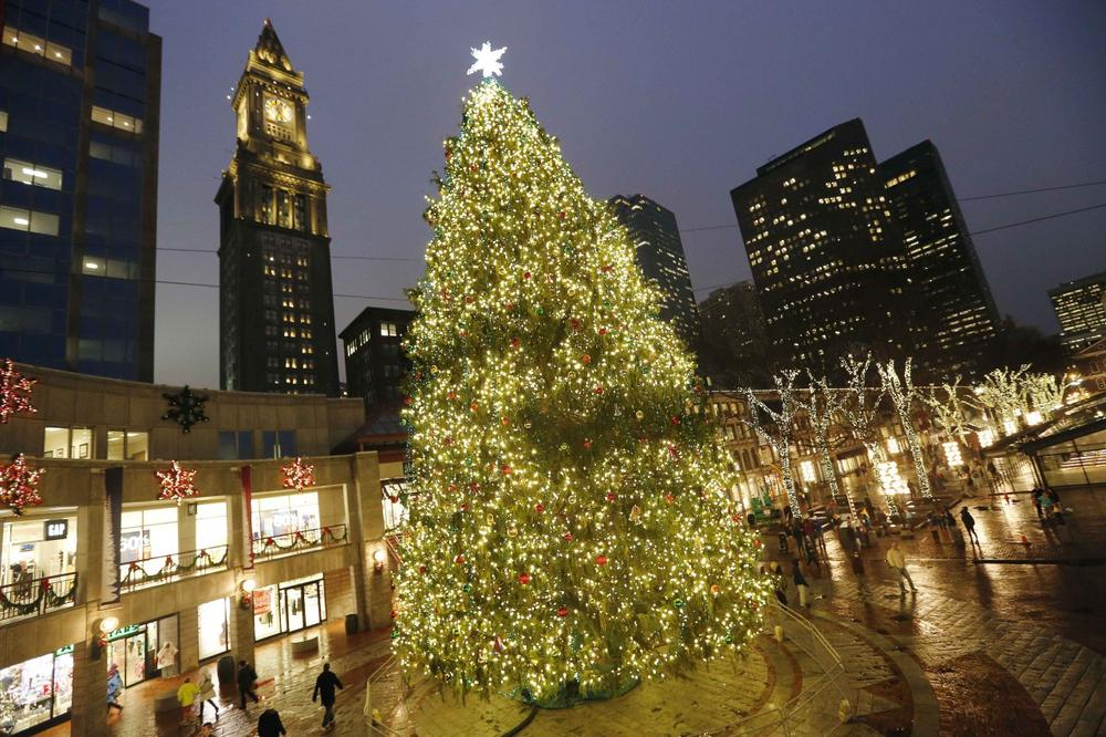 Holiday lights illuminate a concourse at Quincy Market in Boston, Wednesday, Nov. 27, 2013. The holiday season ups the ante - both online and brick-and-mortar retailers can make up to 40 percent of their annual revenue in November and December. (AP Photo/Michael Dwyer)