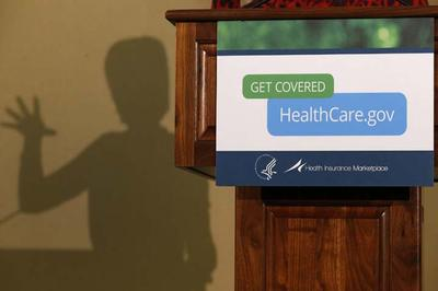 In this Friday, Nov. 15, 2013 photo, the shadow of Health and Human Services Secretary Kathleen Sebelius is shown as she speaks at the Community Health and Social Services Center in Detroit. Technology experts say healing what ails the Healthcare.gov website will be a tougher task than the Obama administration acknowledges (AP)