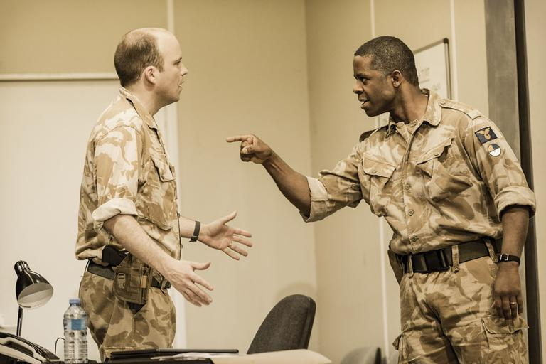 "Iago (Rory Kinnear) and Othello (Adrian Lester) in a scene from the National Theatre's production of ""Othello."" (Johan Persson)"