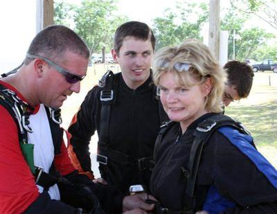 Shirley Dygert is strapped in for the jump by David Hartsock. (Courtesy)