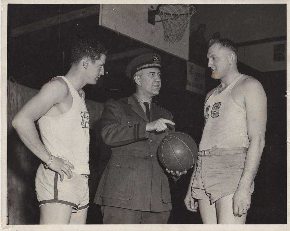 During World War II, Taylor, shown here with Dike Eddleman (l) and Ed Sakdowski (r) coached a military team based at Wright Field in Dayton, Ohio. (Courtesy of Diana Eddleman Lenzi)
