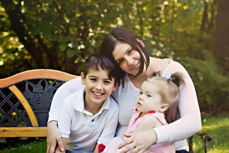 Kate and her children Jake and Brook, who has the fatal genetic disorder Tay-Sachs disease. (Mary White Photography)