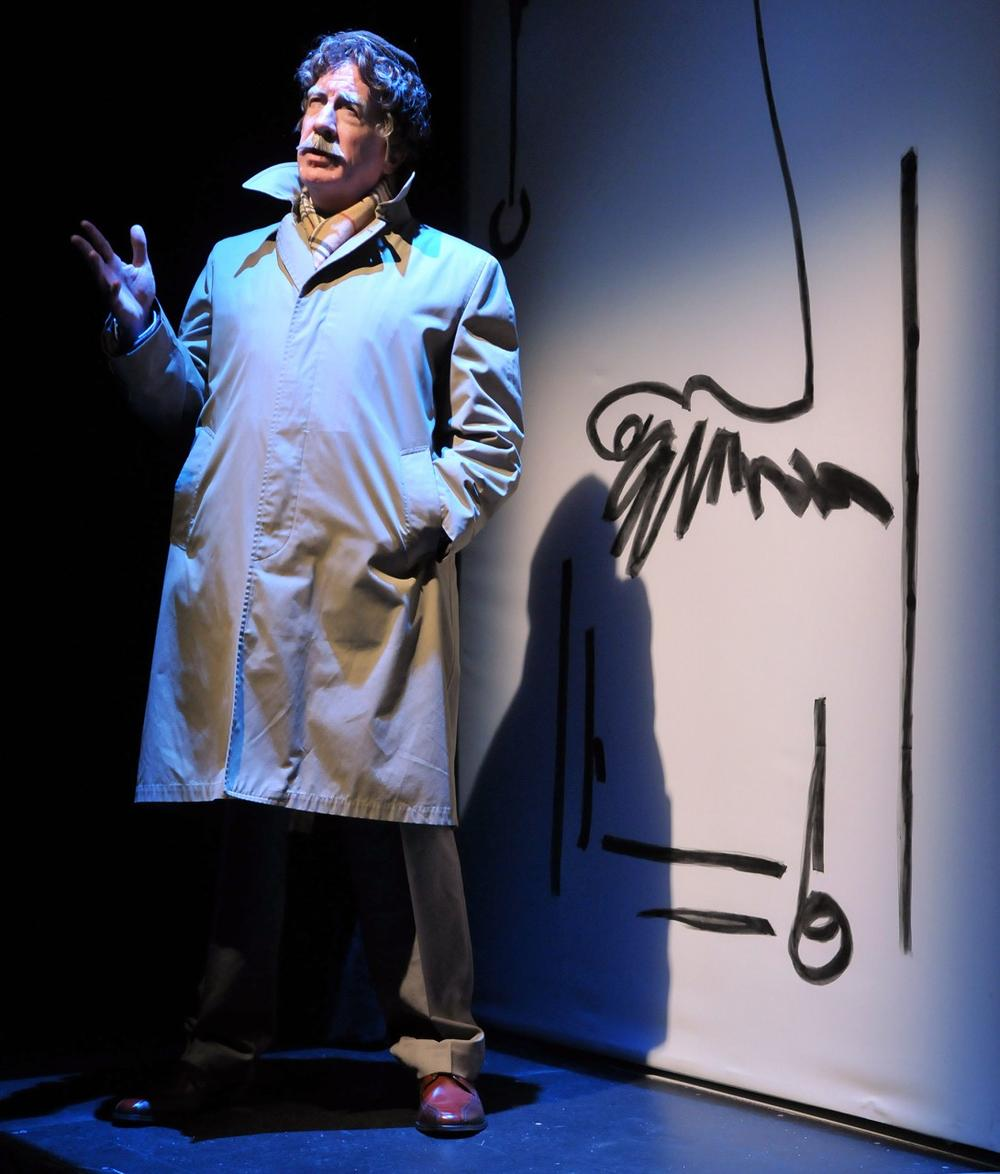 """Richard Snee portraying Kurt Vonnegut in a scene from the SpeakEasy Stage Company World Premiere production of """"Kurt Vonnegut's Make Up Your Mind"""" (Credit: Craig Bailey/Perspective Photo)"""