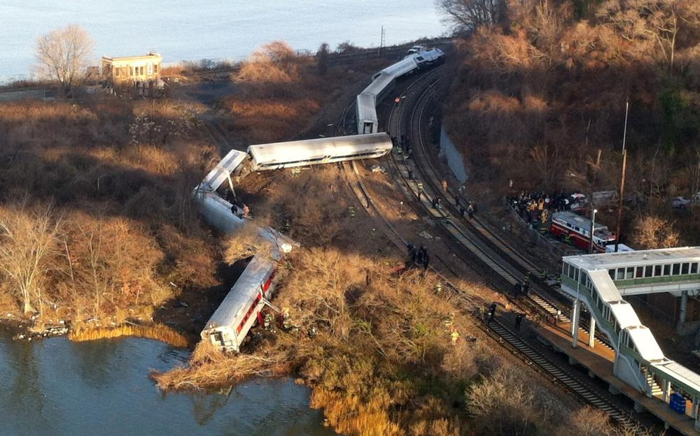 Cars from a Metro-North passenger train are scattered after the train derailed in the Bronx borough of New York, Sunday, Dec. 1, 2013. (Edwin Valero/AP)
