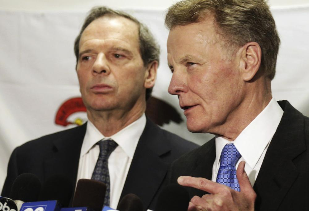 Illinois House Speaker Michael Madigan, with Senate President John Cullerton looking on at left, speaks to reporters after a meeting with Gov. Pat Quinn in Chicago to discuss the state's pension crisis, June 10, 2013. (M. Spencer Green/AP)