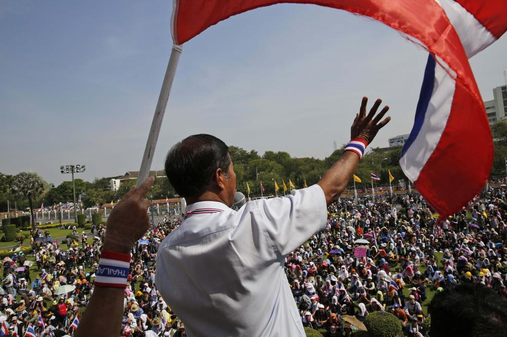 Anti-government protest leader Thaworn Seniam makes a speech on the lawn of Government House in Bangkok, Thailand, Tuesday, Dec. 3, 2013. (Manish Swarup/AP)