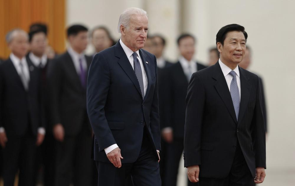 Chinese Vice President Li Yuanchao, right, and U.S. Vice President Joe Biden, left, review an honor guard during a welcome ceremony at the Great Hall of the People in Beijing, China, Wednesday, Dec. 4, 2013. (Lintao Zhang/AP)