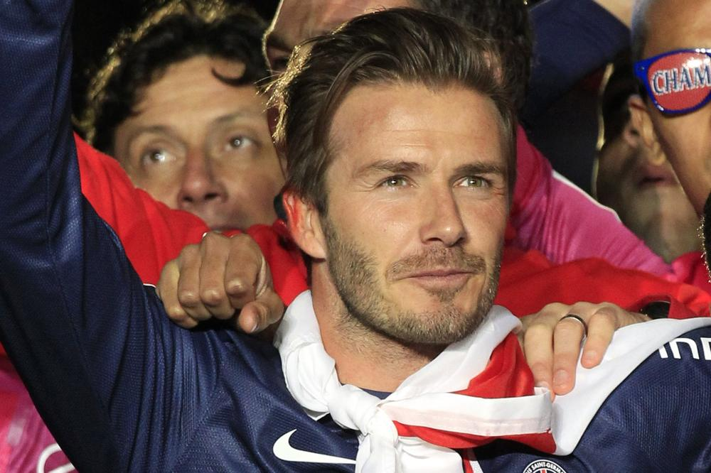 With his playing days behind him, David Beckham is focusing his attention on an MLS franchise partnership with NBA superstar LeBron James. (Thibault Camus/AP)