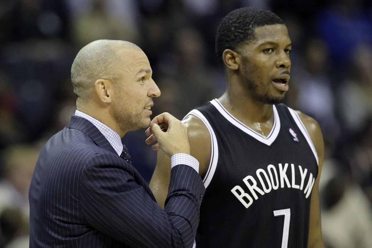 Brooklyn's Jason Kidd, shown here with Joe Johnson, is struggling in his first year as a coach. (Danny Johnston/AP)