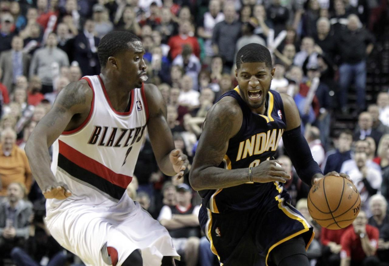 Paul George's (right) stellar play has fueled the Indiana Pacers' hot start. (Don Ryan/AP)