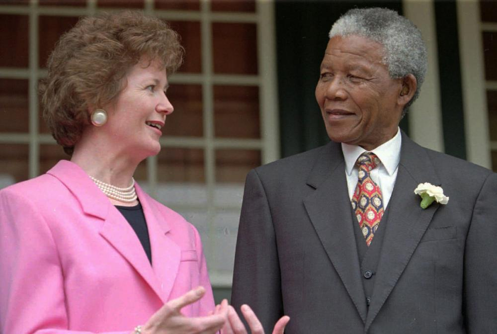Irish President Mary Robinson, left, talks with South African President Nelson Mandela, right, after addressing the national assembly and senators in Cape Town Tuesday March 26 1996. (Guy Tillim/AP)
