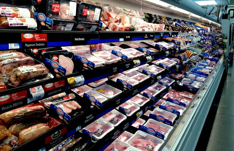 The pork cooler at a Hyvee grocery store in Columbia, Mo., is full of meat. New rules that just went into full effect force meatpackers to detail where much of this meat was born, raised and slaughtered. (Abbie Fentress Swanson/Harvest Public Media)