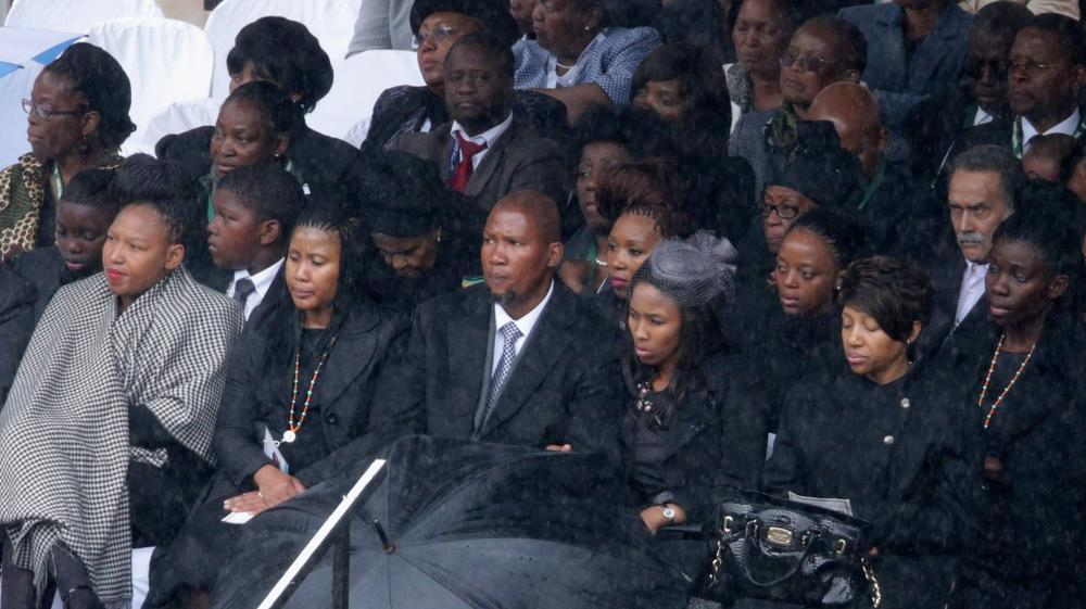 Members of the Mandela family, attend the official memorial service for former South African President Nelson Mandela at FNB Stadium December 10, 2013 in Johannesburg, South Africa. (Photo by Chip Somodevilla/Getty Images)