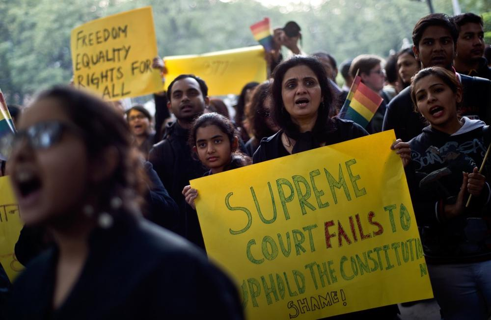 Indian gay-rights activists take part in a protest against the Supreme Court ruling reinstating a ban on gay sex in New Delhi on December 11, 2013. (Manan Vatsyayana/AFP/Getty Images)