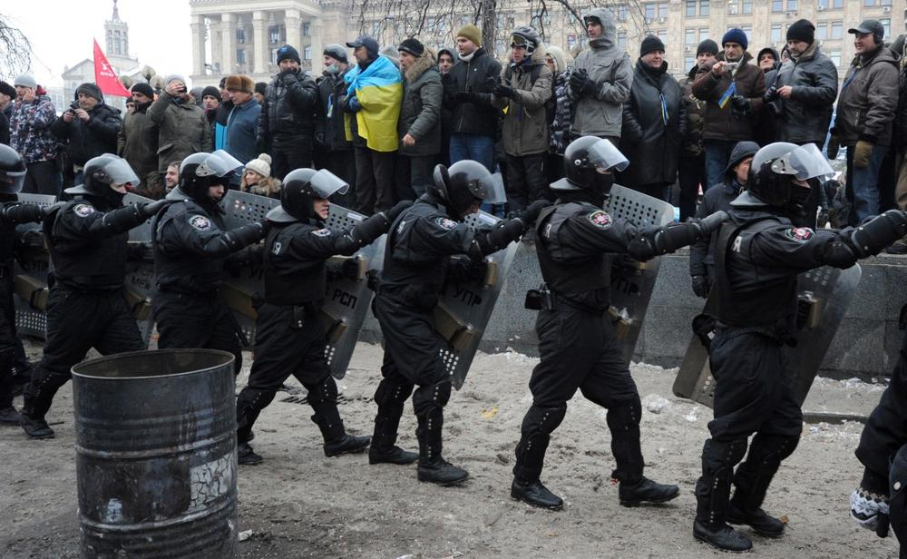 Anti-riot police draw up in front of anti-Yanukovych protesters on Independence Square in Kiev, on December 11, 2013. (Viktor Drachev/AFP/Getty Images)