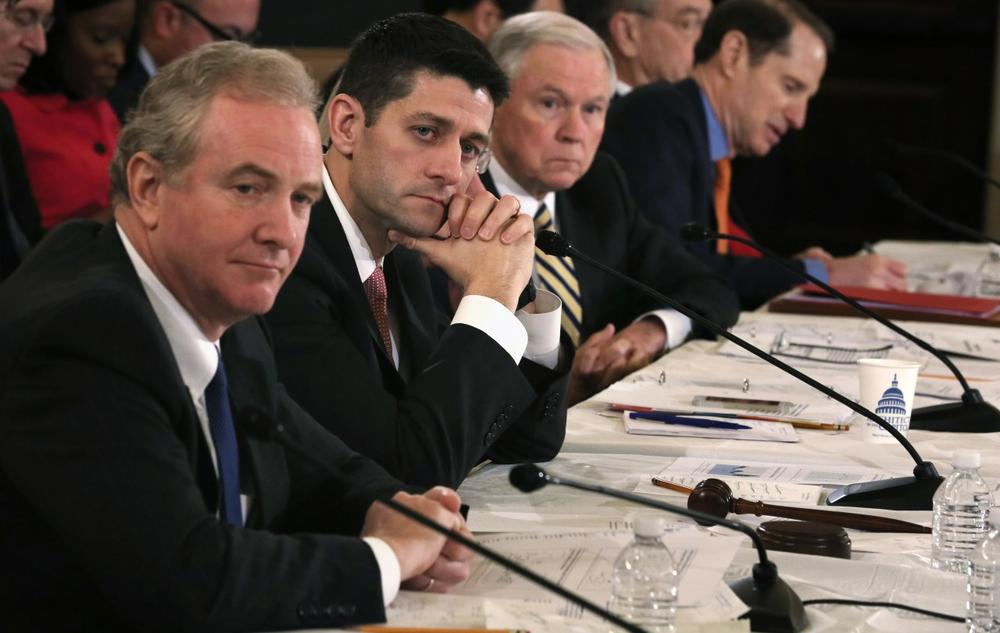 """U.S. Rep. Chris Van Hollen (D-MD), left, says the budget deal is not perfect, """"but it's better than no agreement at all."""" He's pictured with Rep. Paul Ryan (R-WI), Sen. Jeff Sessions (R-AL), and Sen. Ron Wyden (D-OR) during a Conference on the FY2014 Budget Resolution meeting November 13, 2013, in Washington, D.C. (Alex Wong/Getty Images)"""