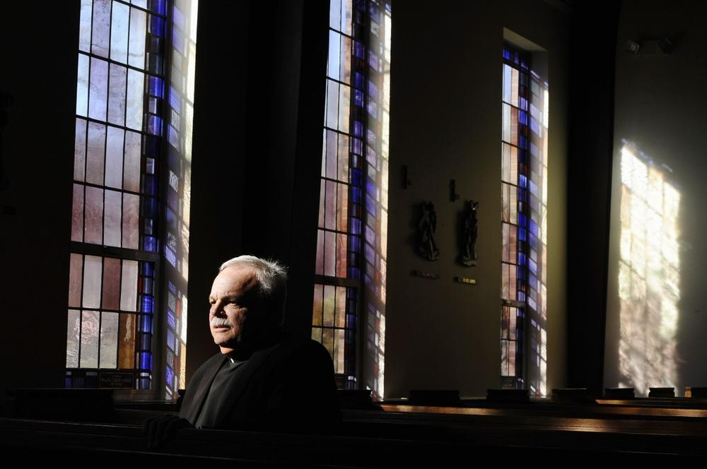 Monsignor Robert Weiss sits in a pew at St. Rose of Lima Roman Catholic Church in Newtown, Conn, Nov. 13, 2013. (Jessica Hill/AP)