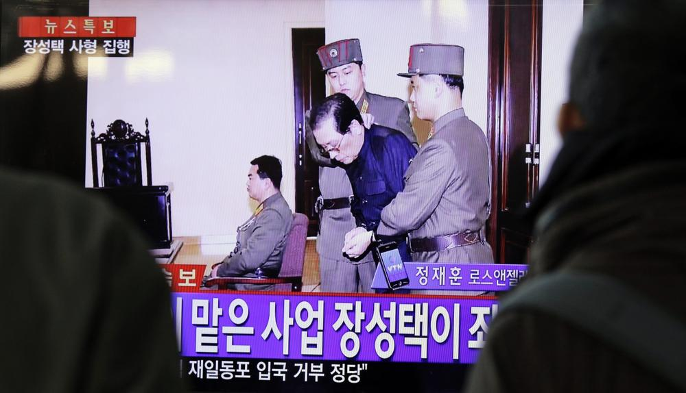 People watch television news showing Jang Song Thaek in court before his execution on December 12, 2013, at the rail station in Seoul on December 13, 2013. (Woohae Cho/AFP/Getty Images)