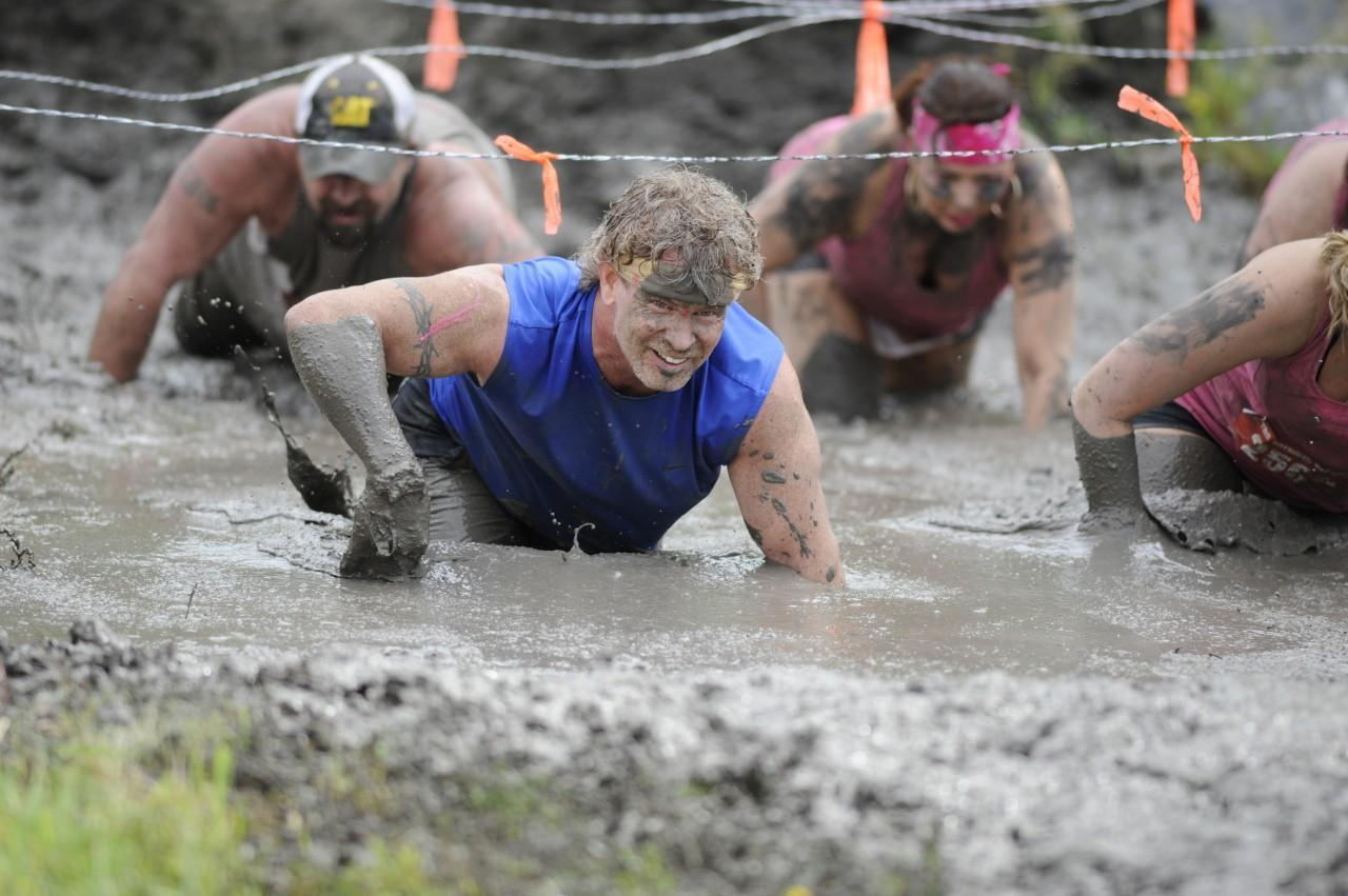 The sport of adventure racing is rapidly growing. Here participants move through the Mud Monster in The Survival Race in Dallas. (J. Dennis Thomas/Nuvision Action Image LLC/AP)