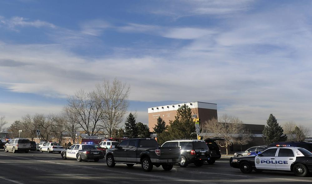 Emergency vehicles sit outside Arapahoe High School after a school shooting on December 13, 2013 in Centennial, Colorado. (Chris Schneider/Getty Images)