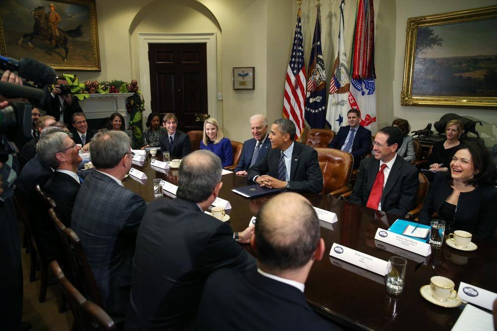 U.S. President Barack Obama and Vice President Joe Biden meet with executives from leading technology companies, including Apple, Twitter and Google, in the Roosevelt Room of the White House on December 17, 2013. (Mark Wilson/Getty Images)
