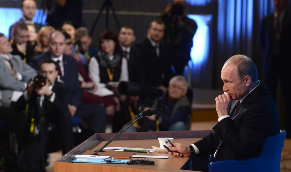 Russia's President Vladimir Putin listens to a question during his annual press conference in Moscow on December 19, 2013. (Vasily Maximov/AFP/Getty Images)