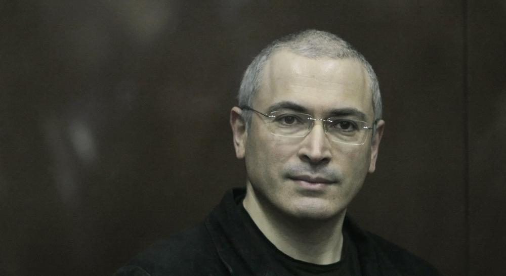 In this Thursday Dec. 30, 2010 file photo Mikhail Khodorkovsky looks from behind a glass enclosure in a court room in Moscow, Russia. Khodorkovsky, the archrival of President Vladimir Putin, has been released from prison after a decade behind bars, his spokeswoman told the Associated Press on Friday. Khodorkovsky spent 10 years in prison on politically tinted charges of tax evasion and embezzlement. (Alexander Zemlianichenko Jr./AP)