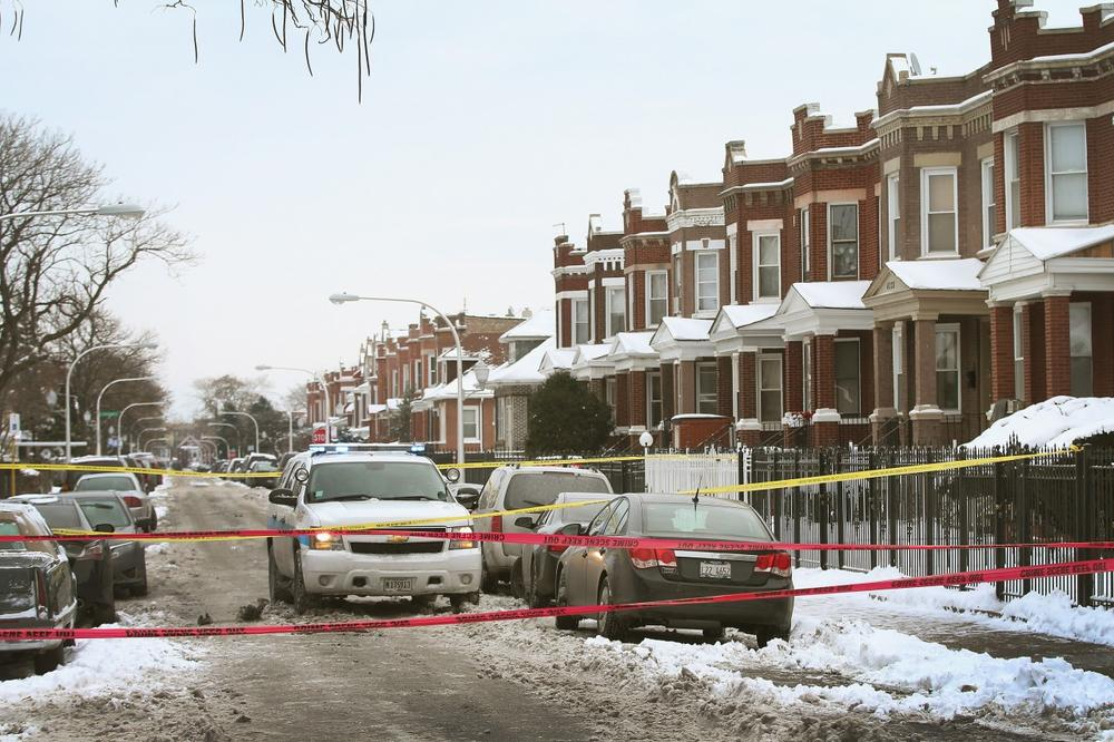 Police investigate a homicide scene in the Lawndale neighborhood on December 15, 2013, in Chicago, Illinois. (Scott Olson/Getty Images )