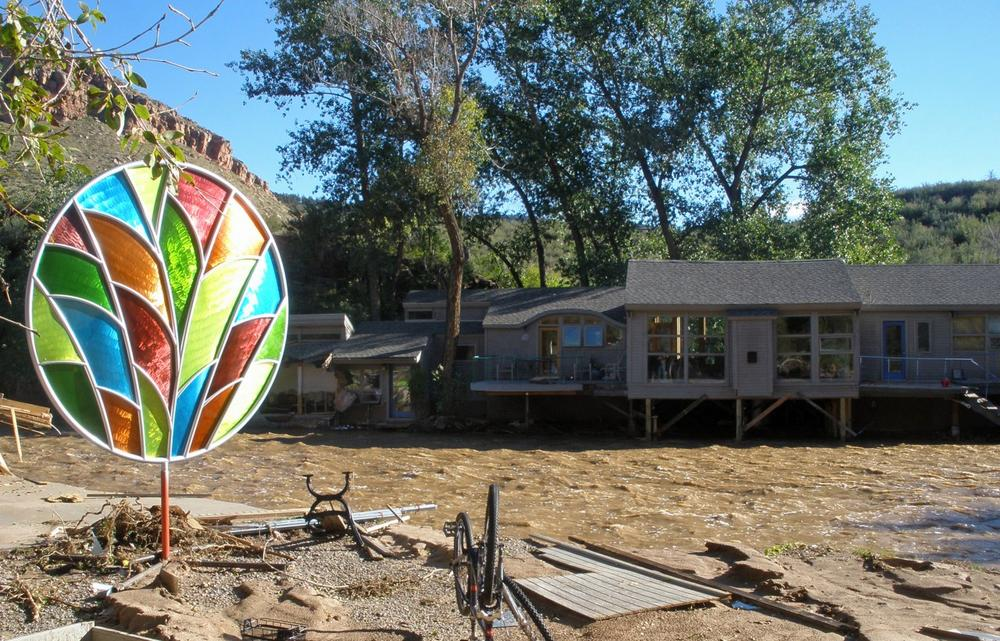 Artist John King took this photo of his property in Lyons, Colo., during the flood. King lost part of his house, his workshop and all of his tools. (John King)