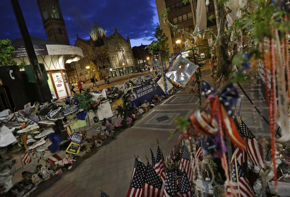 A makeshift memorial remains at Copley Square in Boston, Tuesday evening, May 14, 2013 almost one month after the bombings at the Boston Marathon finish line. (Elise Amendola/AP)