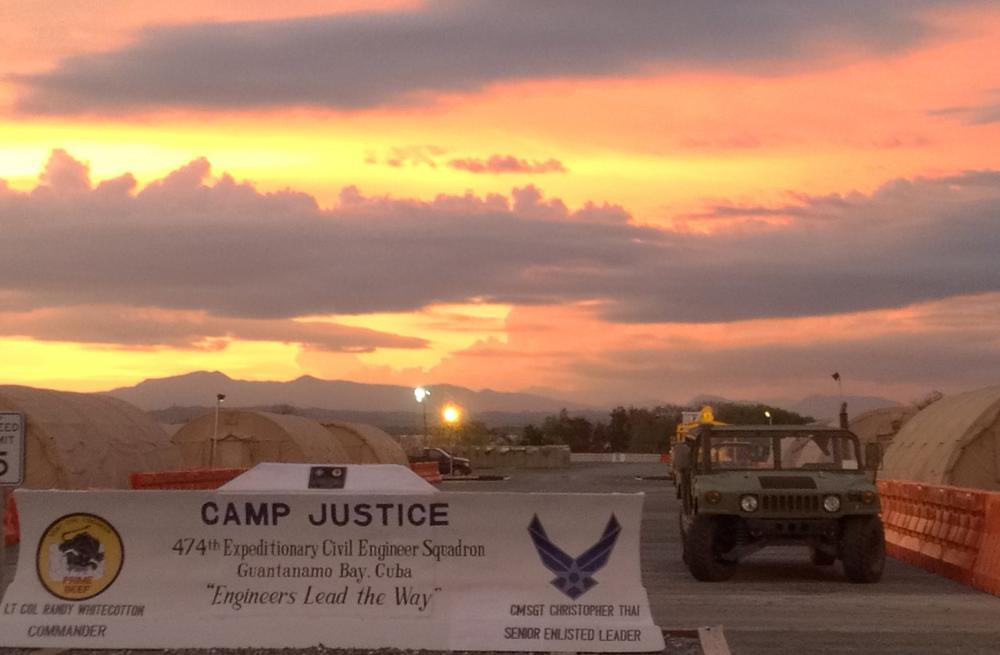 The entrance to Camp Justice at the Guantanamo Bay Naval Base is seen on October 24, 2013, in Guantanamo Bay, Cuba. The tents at Camp Justice house media, lawyers, human rights observers, and military personnel. (Chantal Valery/AFP/Getty Images)