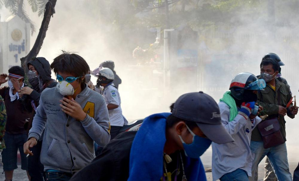 Thai anti-government protesters run from tear gas during a protest to disrupt elections in Bangkok. (AFP/Getty Images)