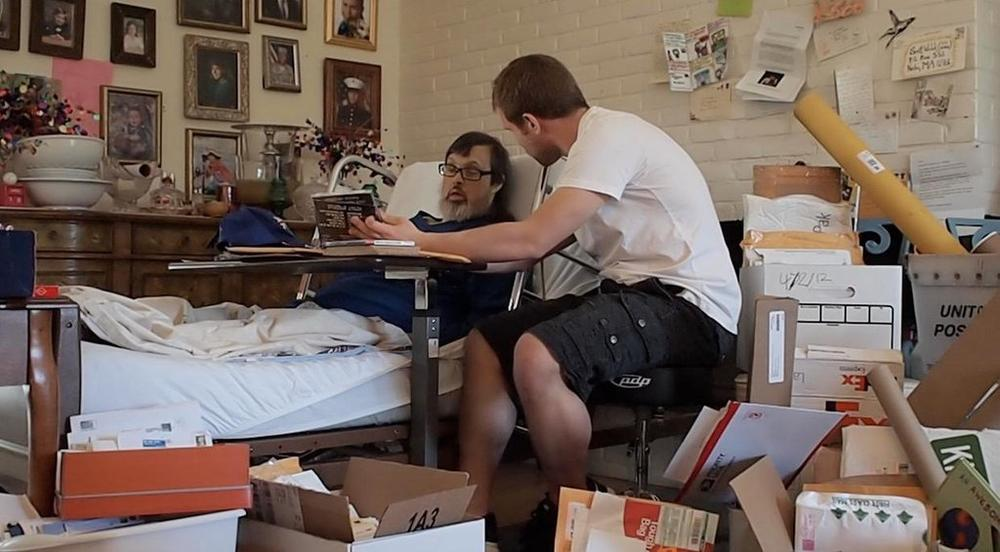 Sean O'Connor sits with his uncle, Scott Widak, surrounded by boxes of mail. (Courtesy of the Widak family)