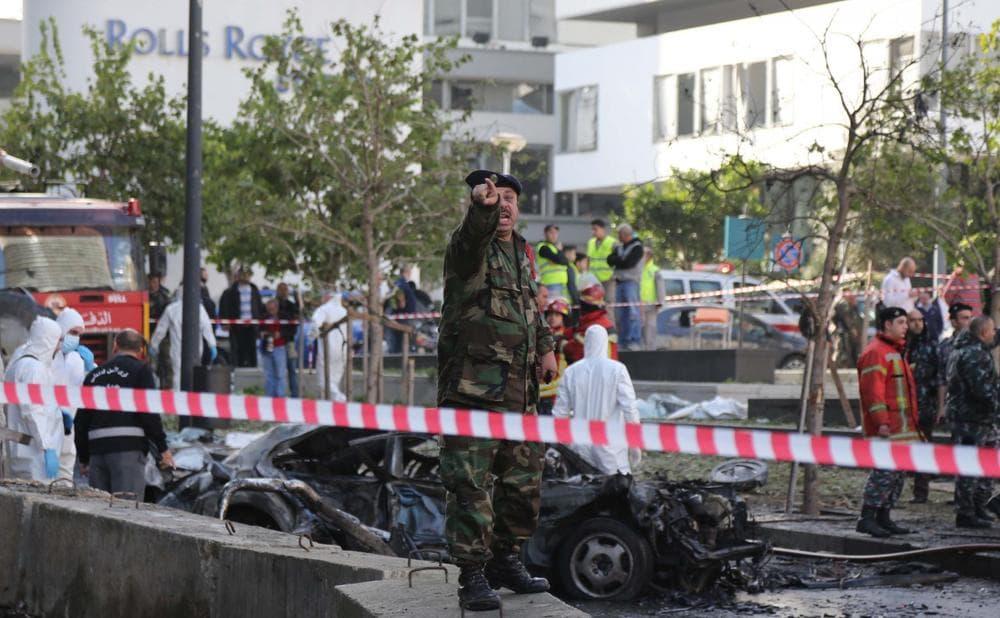 Lebanese security forces inspect the scene of a huge car bomb explosion that rocked central Beirut on December 27, 2013, killing Mohamed Chatah, former finance minister and adviser to Lebanese ex-premier Saad Hariri (STR/AFP/Getty Images)