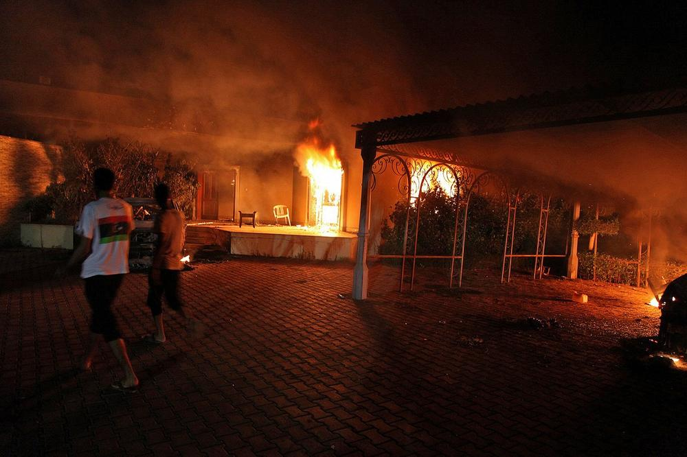 A vehicle (R) and the surround buildings burn after they were set on fire inside the US consulate compound in Benghazi late on September 11, 2012. (STR/AFP/Getty Images)