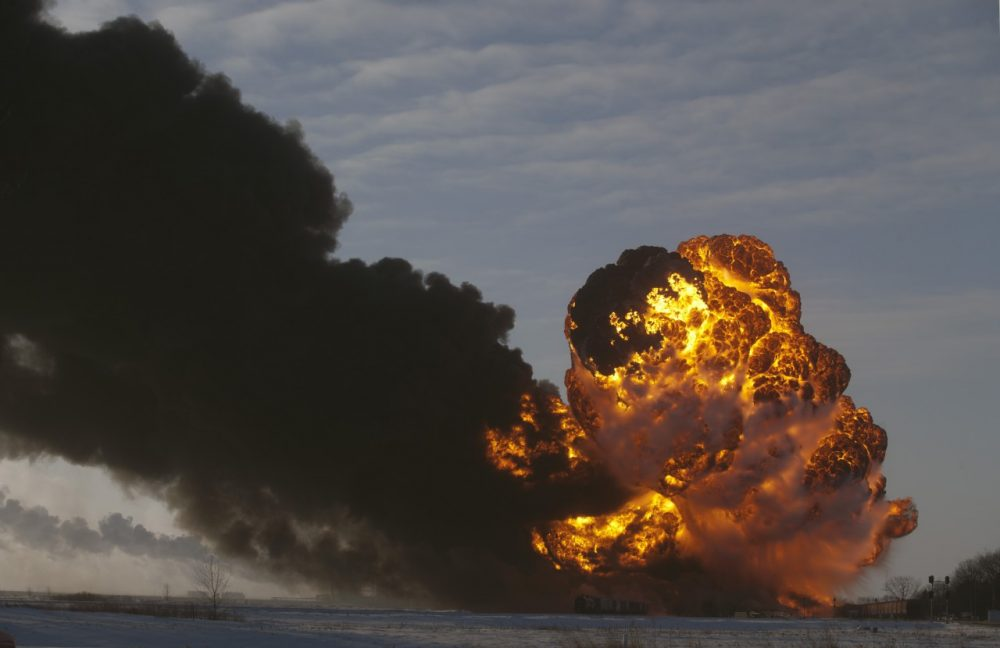 A fireball goes up at the site of an oil train derailment Monday, Dec 30, 2013, in Casselton, N.D. The train carrying crude oil derailed near Casselton Monday afternoon. Several explosions were reported as some cars on the mile-long train caught fire. (Bruce Crummy/AP)