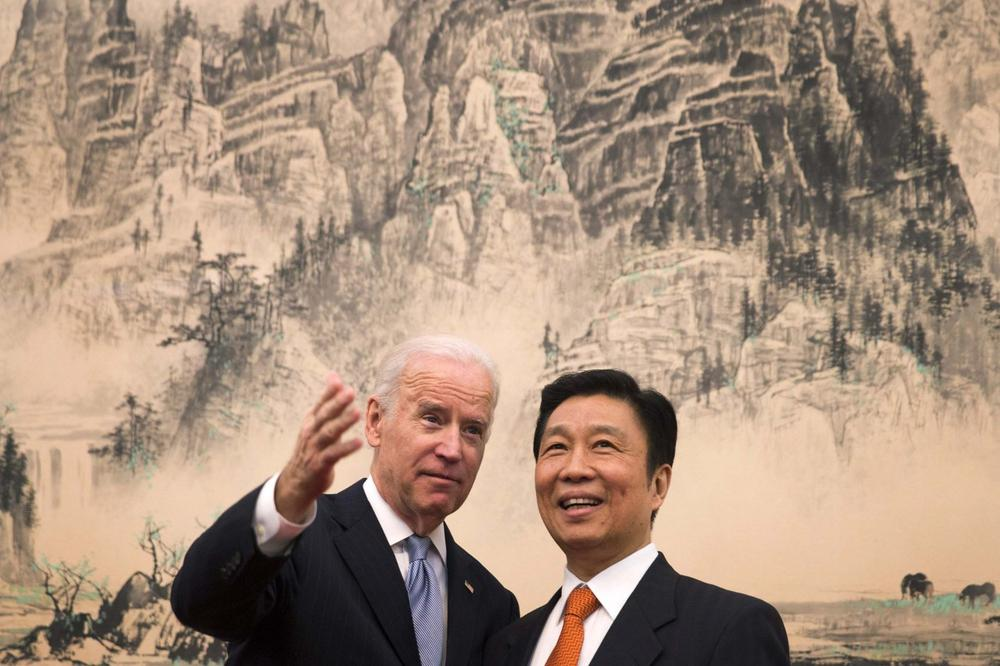 U.S. Vice President Joe Biden, left, chats with his Chinese counterpart Li Yuanchao before heading to their luncheon at the Diaoyutai State Guesthouse in Beijing, China Thursday, Dec. 5, 2013. (AP)
