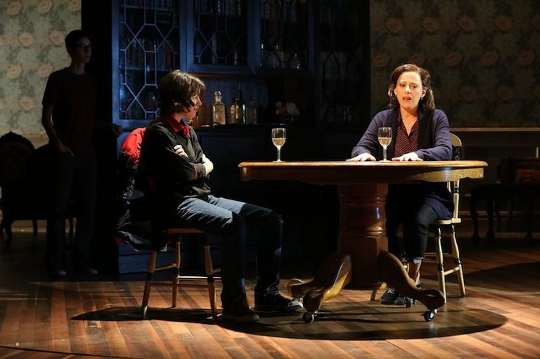 "Judy Kuhn (right) sings of her heartbreaking relationship with her gay husband in ""Fun Home."" Beth Malone (rear) and Alexandra Soccha as Alison Bechdel at different ages listen. (Joan Marcus)"