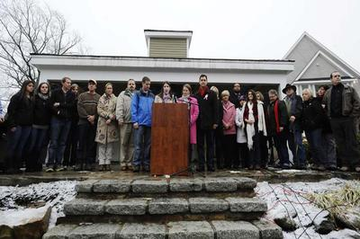 Family members representing fourteen of the twenty-six victims from the Sandy Hook Elementary School shooting address the media, Monday, Dec. 9, 2013, in Newtown, Conn. Newtown is not hosting formal events to mark the anniversary Saturday. (AP)