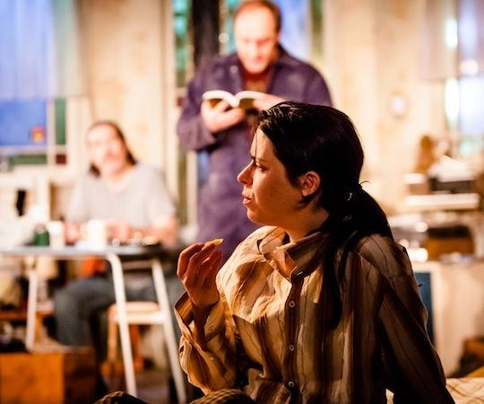 """Caoilfhionn Dunne (foreground) with Ciarán Hinds and Michael McElhatton in Conor McPherson's """"The Night Alive"""" at the Atlantic Theater Company. (Helen Warner)"""