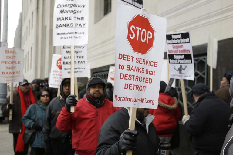 Detroit city workers and supporters protest outside the federal courthouse in Detroit while awaiting the bankruptcy decision, Tuesday, Dec. 3, 2013. Judge Steven Rhodes announced Tuesday that the city the biggest city in U.S. history to enter bankruptcy. (AP)