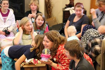 Members of the polygamous Brown family of Utah gather for a Christmas gift exchange. A lawsuit the family brought against a Utah statute banning polygamous-style co-habitation was successful in a court ruling in late December. (DCL / TLC)