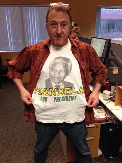 "On Point producer Stefano Kotsonis shows off his ""Mandela For President"" t-shirt in the WBUR offices. (Nick Andersen / WBUR)"