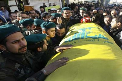 "Hezbollah fighters, left, mourn as they carry the coffin of their commander Ali Bazzi, who was killed in Syria during a battle against the Syrian rebels, during his funeral procession, in the southern port city of Sidon, Lebanon, on Monday, Dec. 9, 2013. Hezbollah announced that two of its members, including a local commander, were killed while ""performing their jihadi duties."" Syrian troops captured a western town near the country's main north-south highway on Monday as the government forged ahead with a punishing offensive in a mountainous region near the border with Lebanon, state media said. (AP)"
