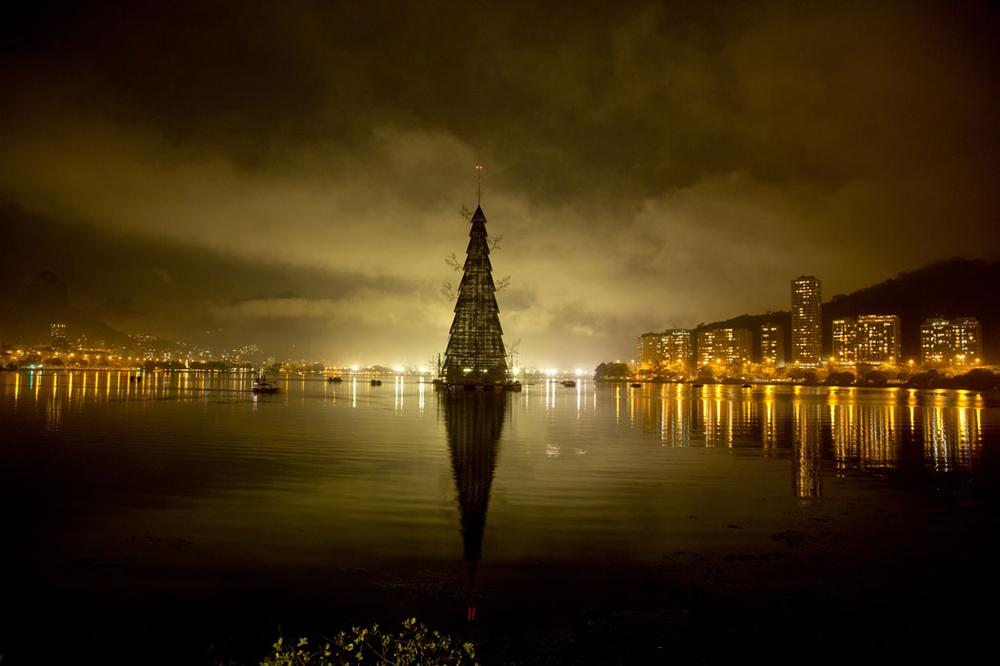 A Christmas tree (pictured above and at top) floats in Lagoa Lake during the annual holiday tree lighting in Rio de Janeiro, Brazil, on Nov. 30, 2013. (AP Photo/Victor R. Caivano)