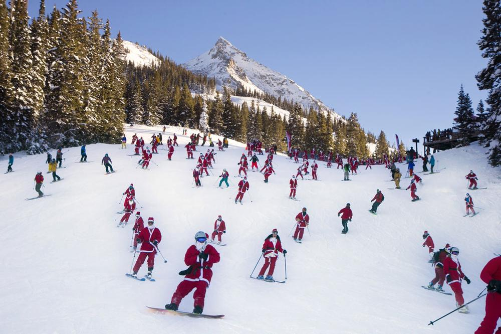 "More than 425 people dressed as Santas participated in the ""Santa Ski Crawl"" skiing from Uley's Ice Bar at Crested Butte Mountain Resort in Colorado on Dec. 14, 2013. (AP Photo/Crested Butte Mountain Resort, Nathan Bilow)"