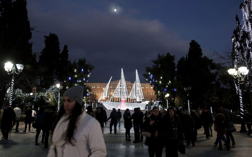 An illuminated boat—an old Greek symbol—decorates Athens' Syntagma Square in front of the Greek parliament on Dec. 13, 2013. (AP Photo/Petros Giannakouris)