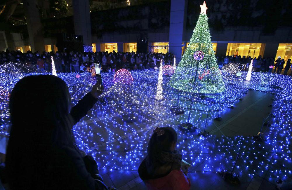 People gather to watch Christmas Illuminations in Tokyo, Japan, on Dec. 7, 2013. (AP Photo/Koji Sasahara)